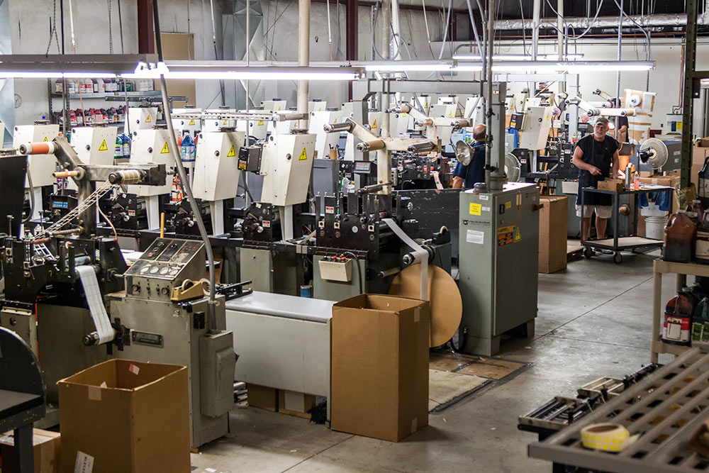 Men working in industrial printing facility